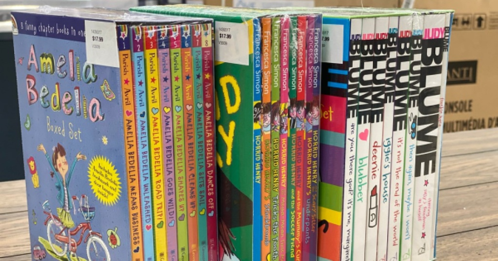 three complete children book sets on shelf at costco