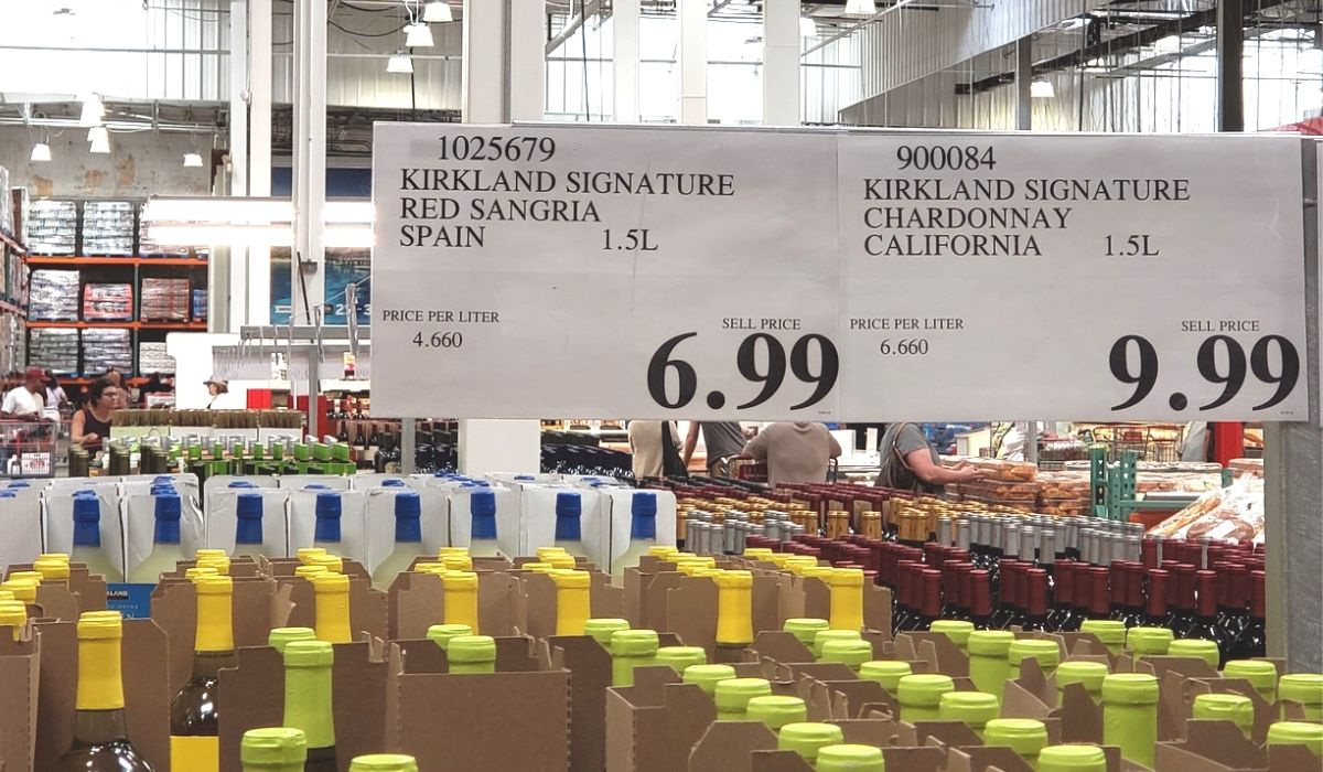 Wine deals displayed on signs at Costco