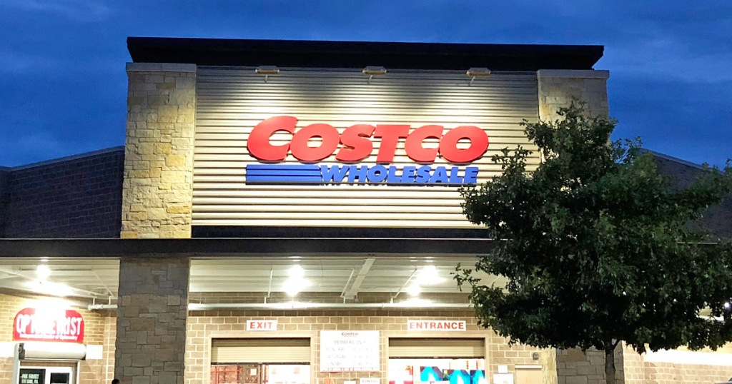 costco storefront at dusk with tree in front