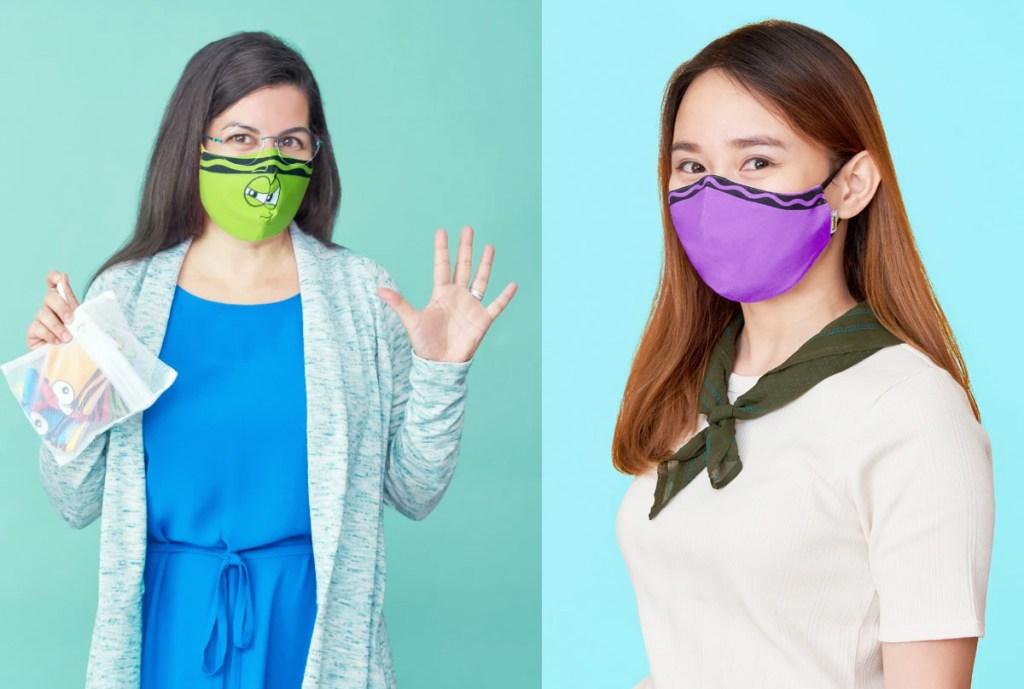 two women molding crayola themed face masks
