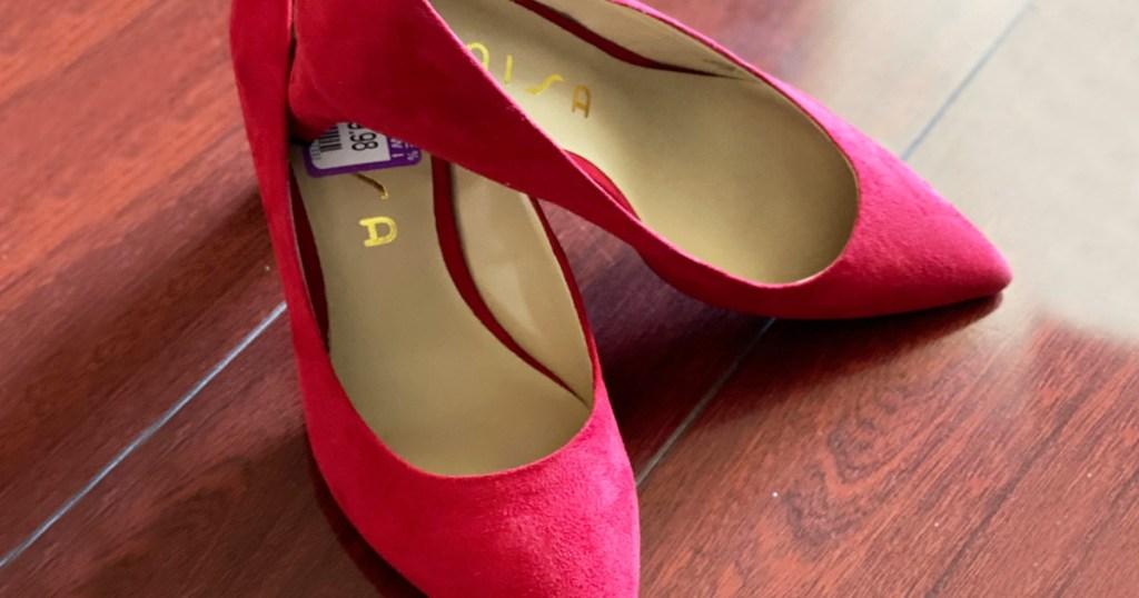 pair of red women's pump sandals on hardwood floor