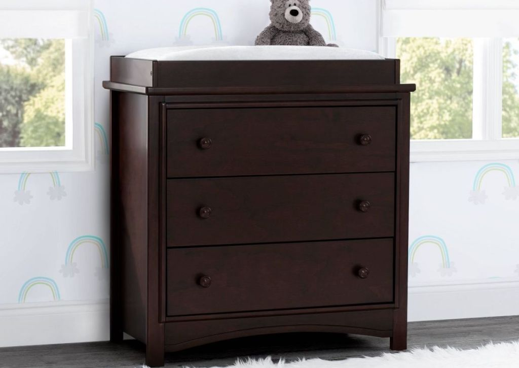 brown dresser with bear on top