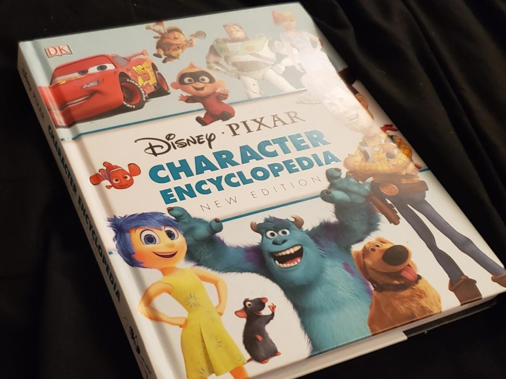 brightly colored book with Disney characters on the front