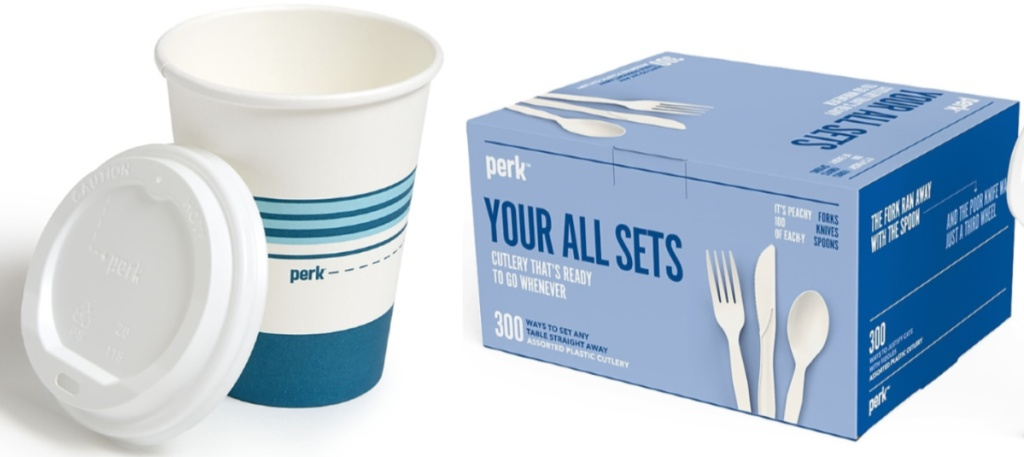 Disposable paper with a lid sitting next to a box of plastic cutlery