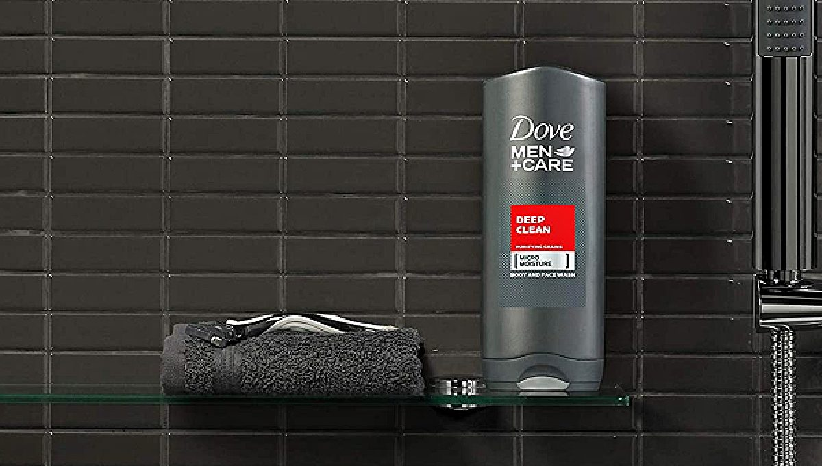 bottle of men's body wash on shelf in shower