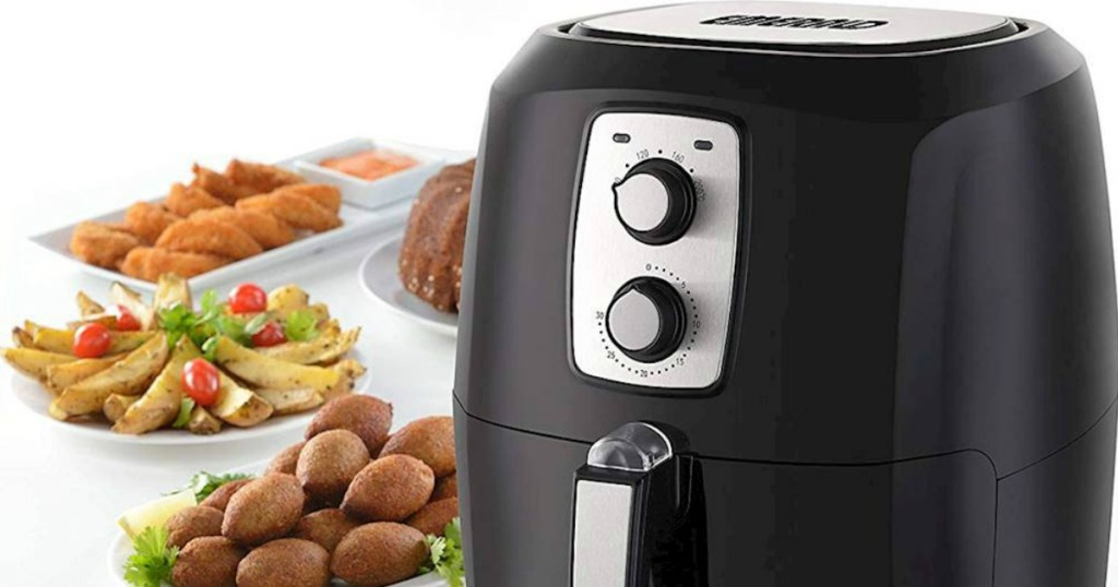 air fryer with food on table next to it