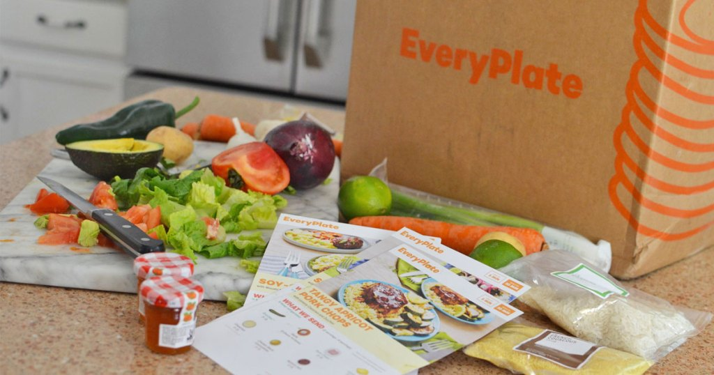 Everyplate shipping box on kitchen counter with fresh ingredients and recipe cards in front of it