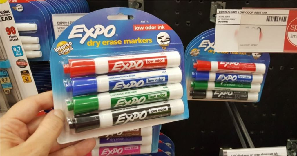 woman hand holding 4 pack of expo dry erase markers