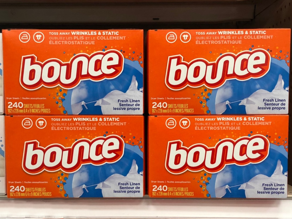 4 large boxes of bounce fabric softener sheets on a store shelf