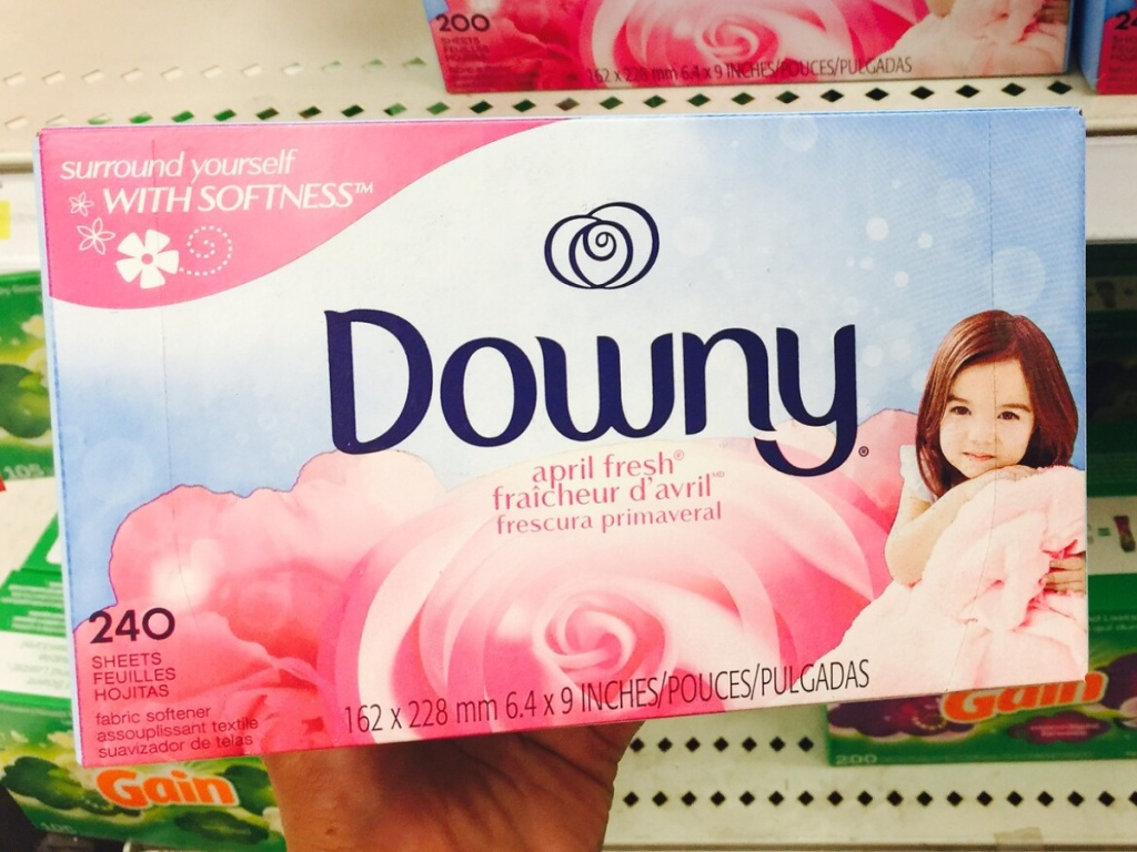 hand holding a large light pink and blue box of fabric softener sheets in store