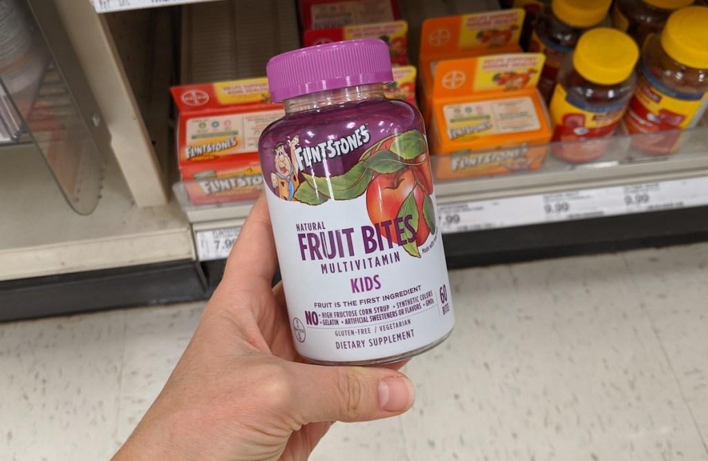 hand holding bottle of Flinstones Fruit Bites