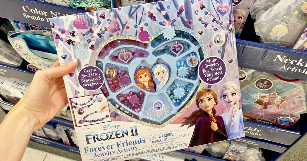 person holding up a disney frozen jewelry making set