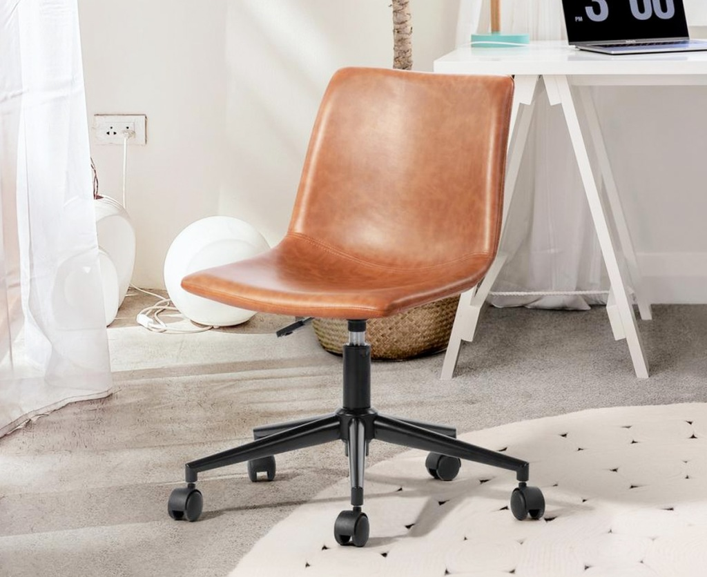tan colored faux leather armless office chair near white desk