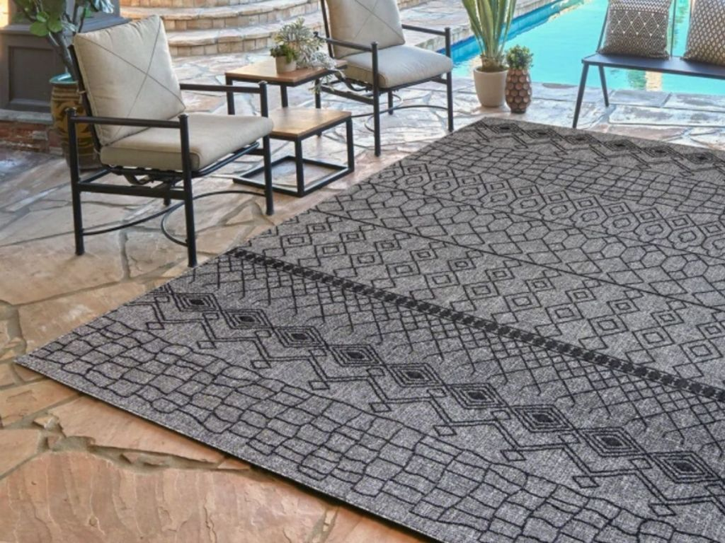 area rug on patio witch chairs