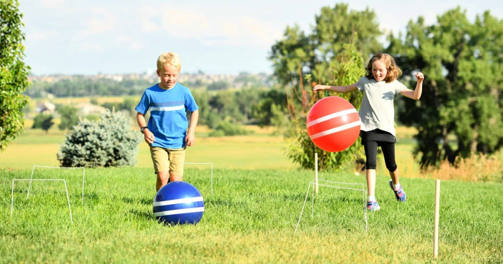 kids playing with a Giant Games Giant Kick Croquet