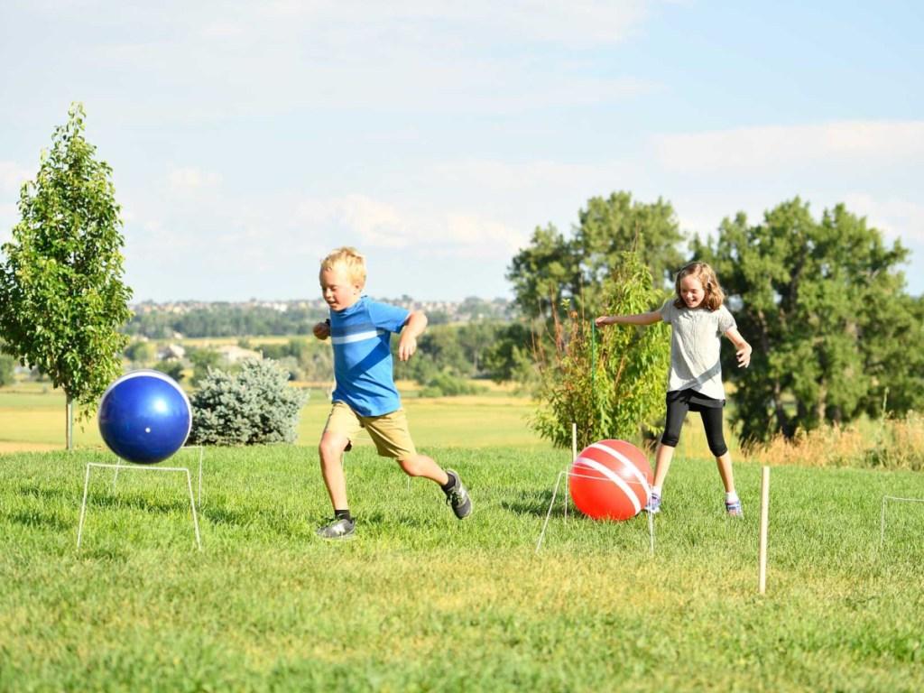 kids playing Giant Kick Croquet