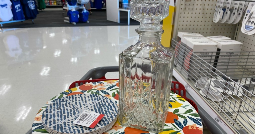 glass decanter sitting on a plate