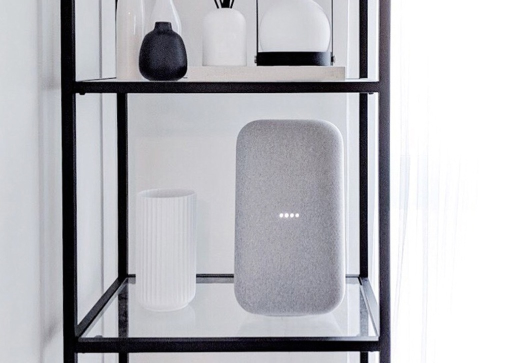 grey google home speaker on decorative shelf