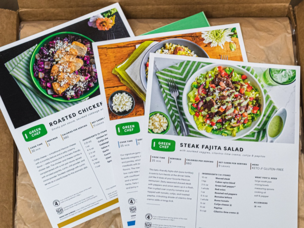 3 green chef meal kit cards sitting on a cardboard