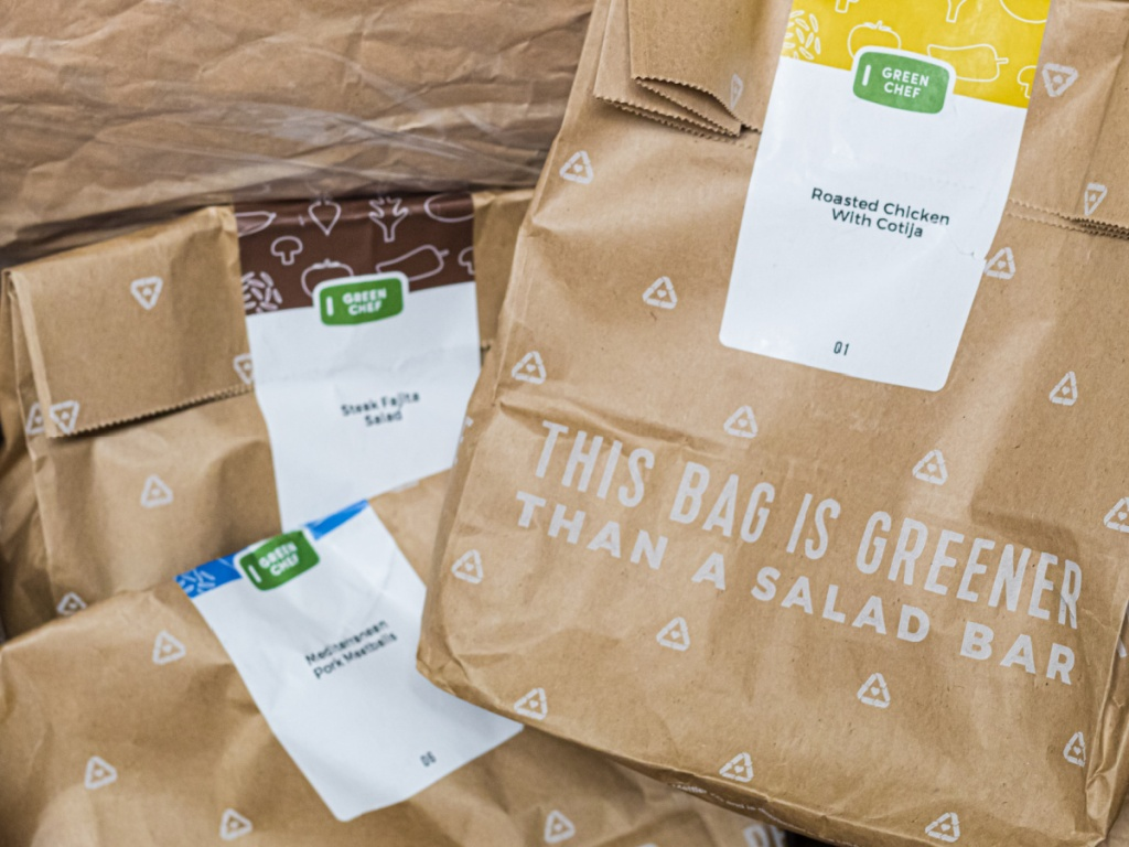 green chef meal kit with brown bags with groceries