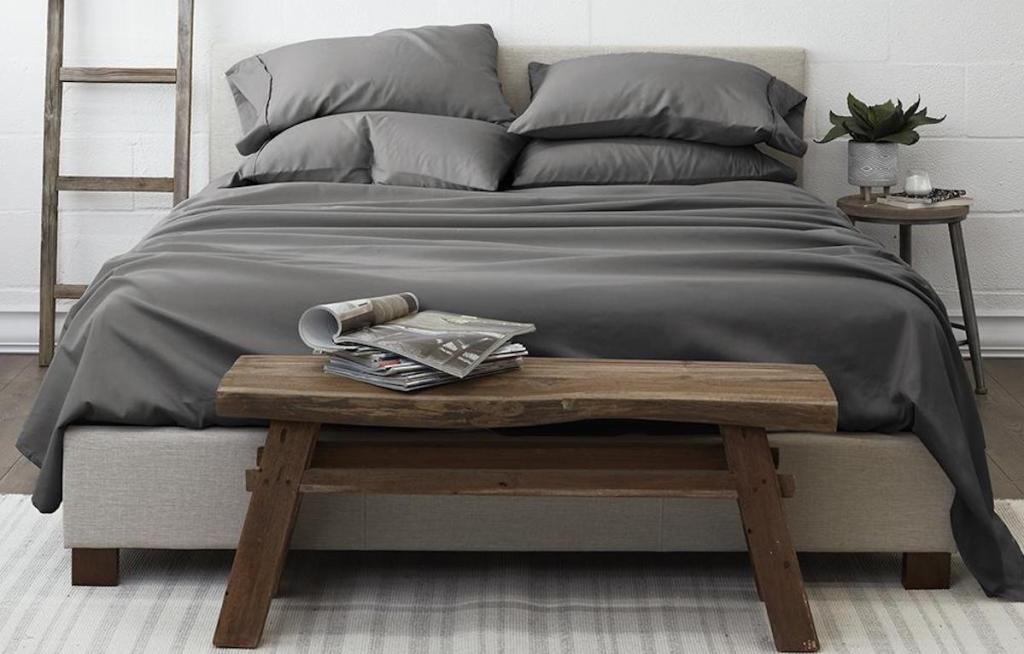 dark grey linen and hutch on queen bed in bedroom