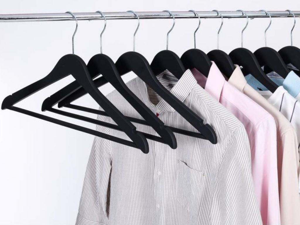 rubber coated wood-like hangers on closet bar with button down shirts hanging on half