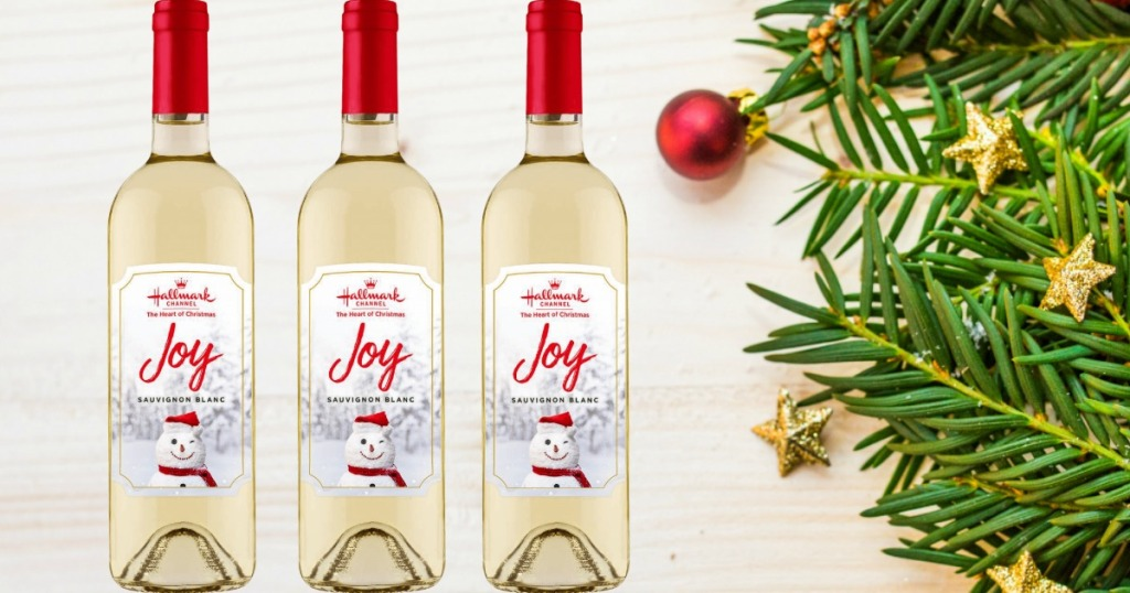 three Hallmark wines by bough of evergreen