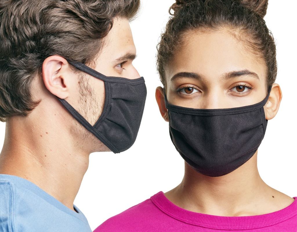 man in light blue shirt and woman in pink shirt both wearing matching black face masks