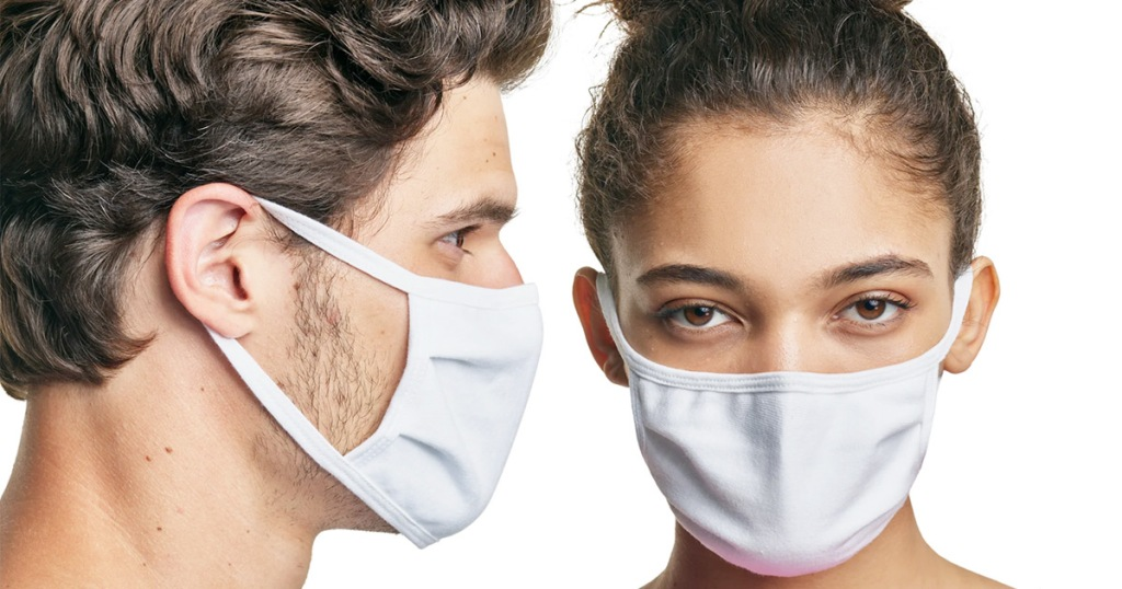 man and woman both wearing matching white face masks