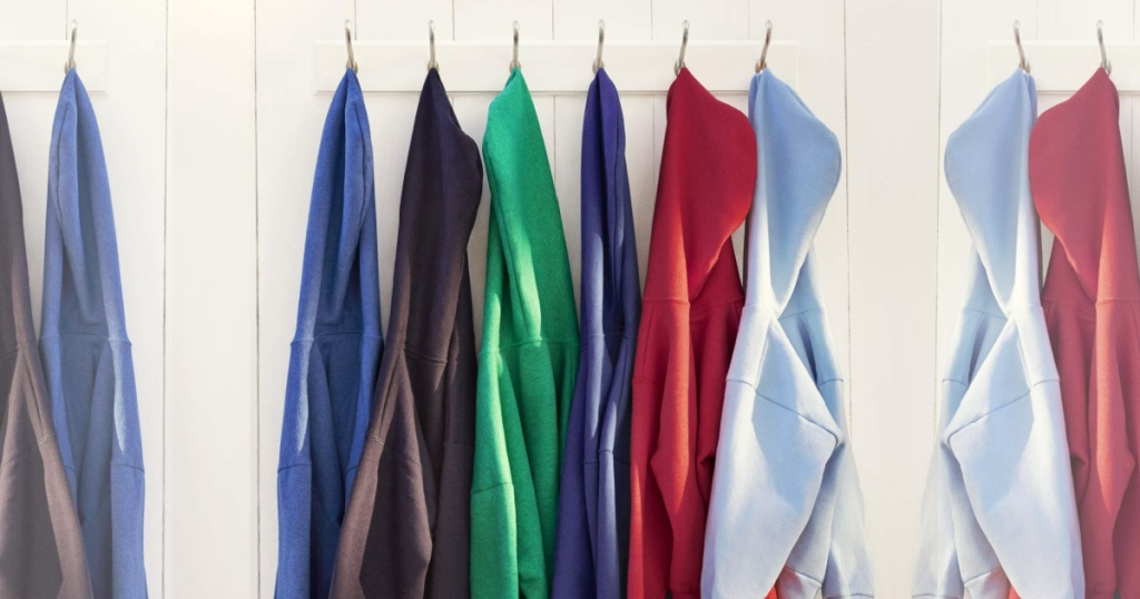 assorted Hanes Mens Pullover Ecosmart Fleece Hooded Sweatshirts hanging on hooks