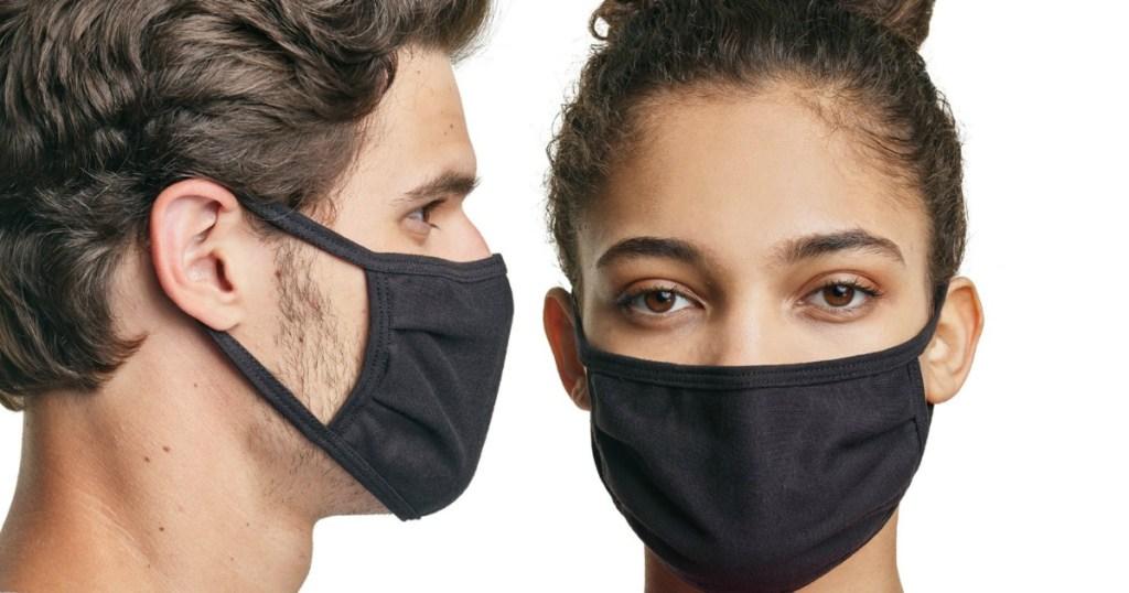 man and woman wearing black face masks