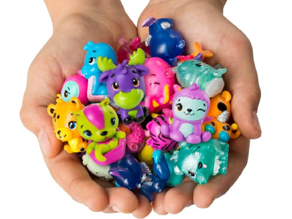 hand holding lots of hatchimals