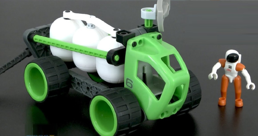 kids green and black robotics fuel toys on black table
