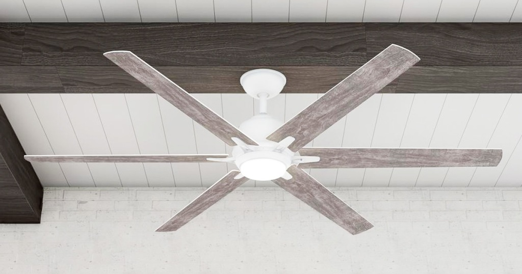 white ceiling fan with wood grain fan blades on a dark brown beam on white ceiling