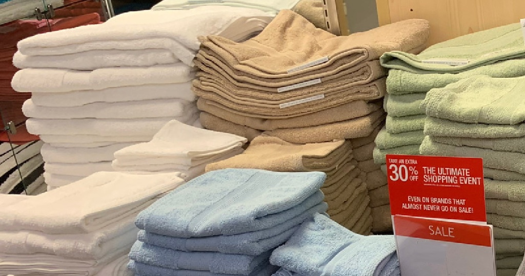various colored bath towels on display in store