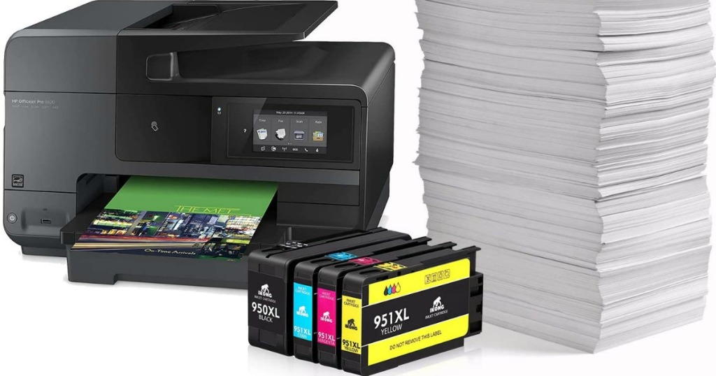 ink cartridges in front of printer and stack of paper