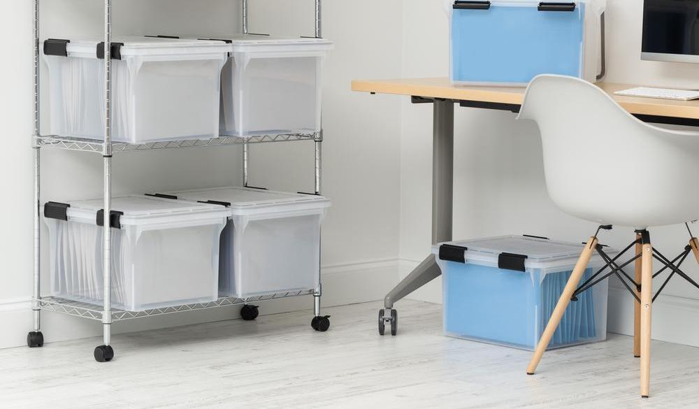 storage bins on shelf next to a desk