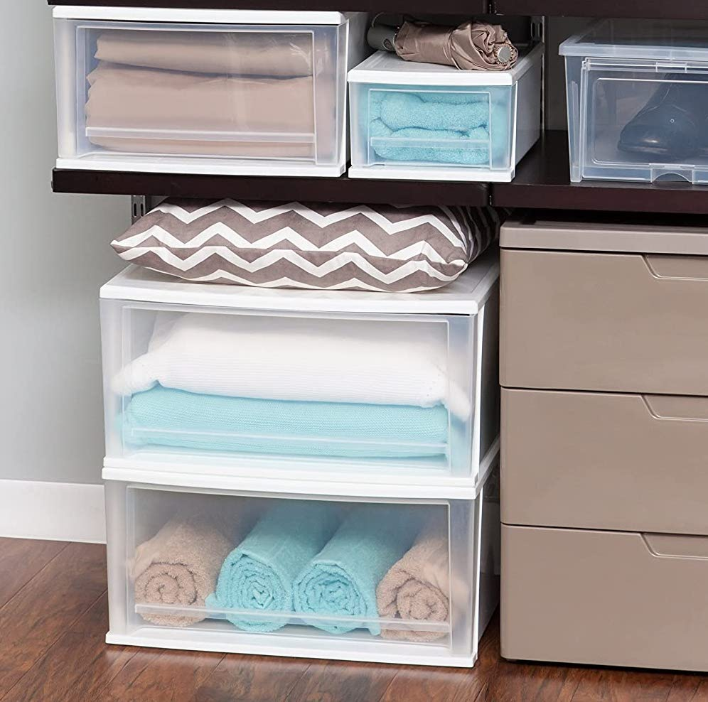 storage drawers with towels in them
