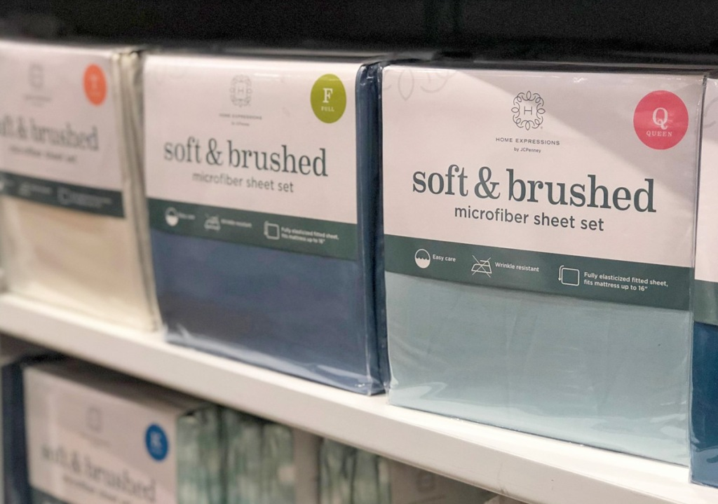 plastic packages of microfiber sheet sets on store display shelf