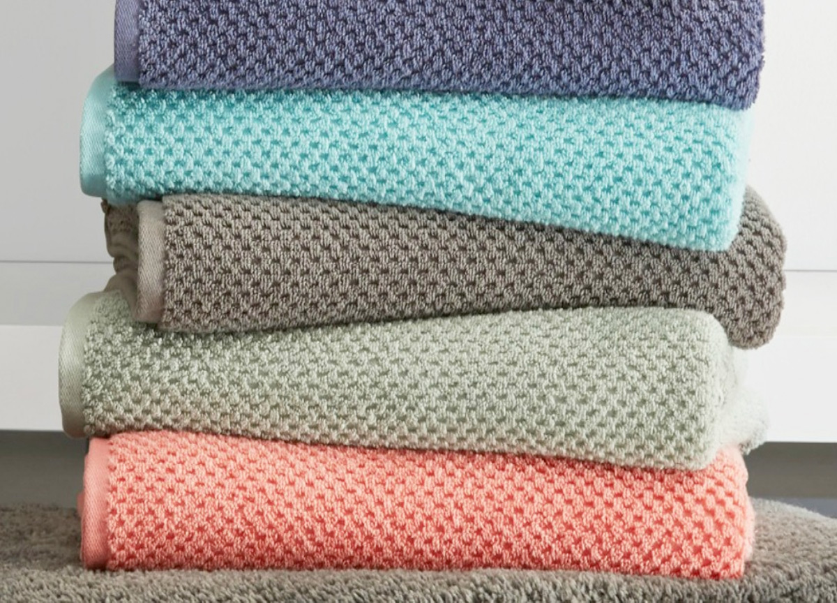 stack of textured bath towels in various colors
