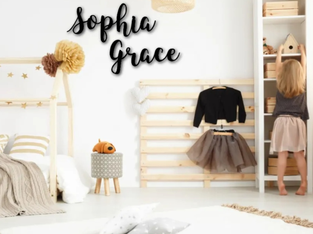 Sophia Grace personalized wooden name sign on a white wall in a little girls room