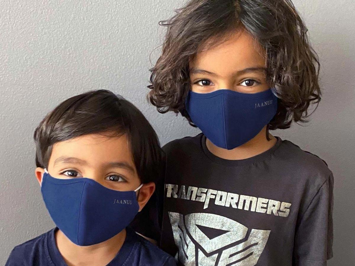 two kids wearing face masks