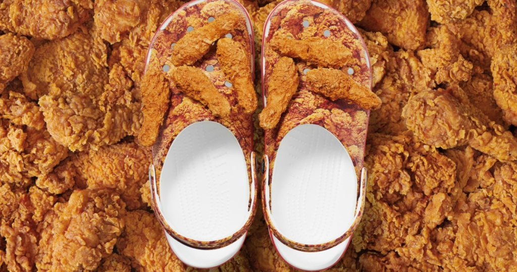 pair of kfc crocs with fried chicken in the background