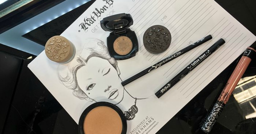 Kat Von D Cosmetics laid on table