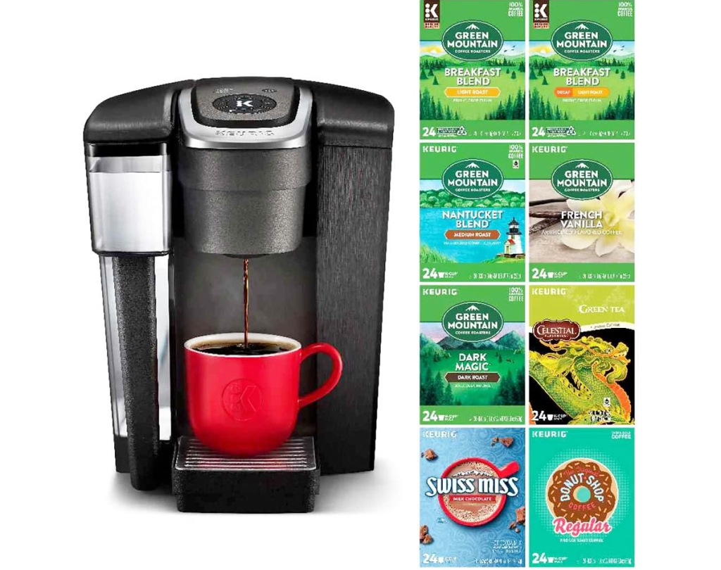 black keurig brewer with red coffee cup and 8 boxes of a variety of coffee pods