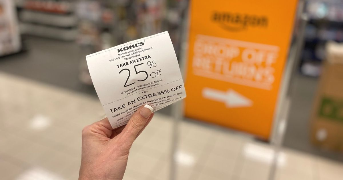 A hand holding a Kohl's receipt with a 25% off coupon