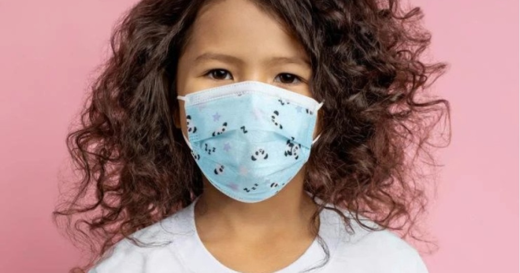 young girl wearing a blue disposable face mask