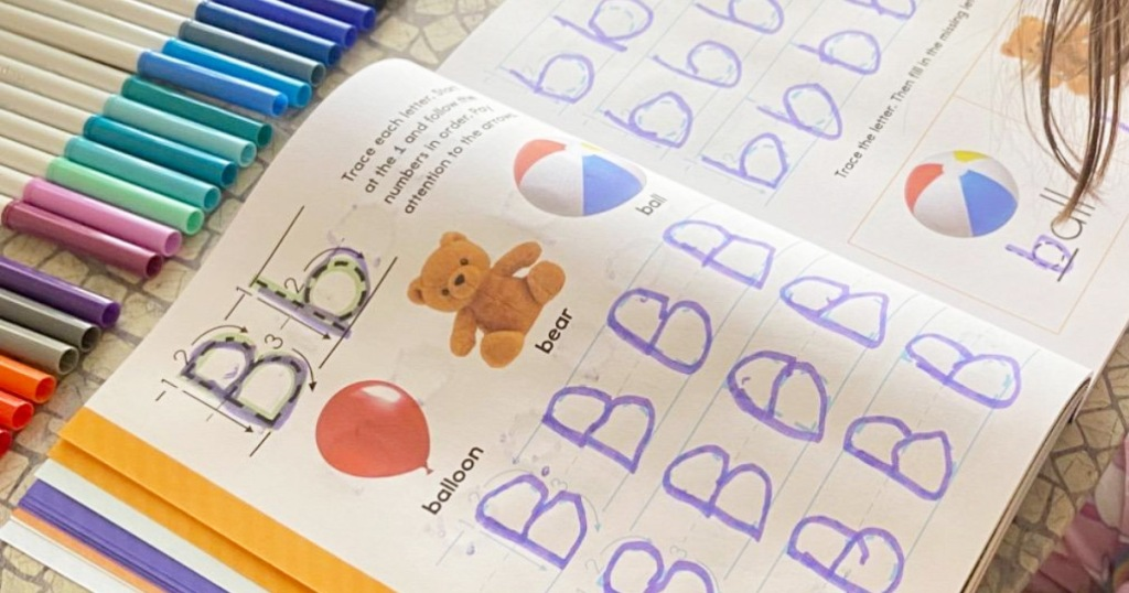 child's learn to write workbook filled in tracing the letter B in purple marker