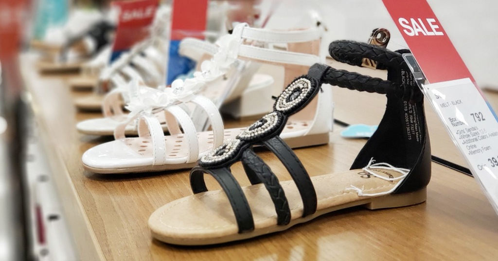 store display of girls gladiator sandals in black and white colors