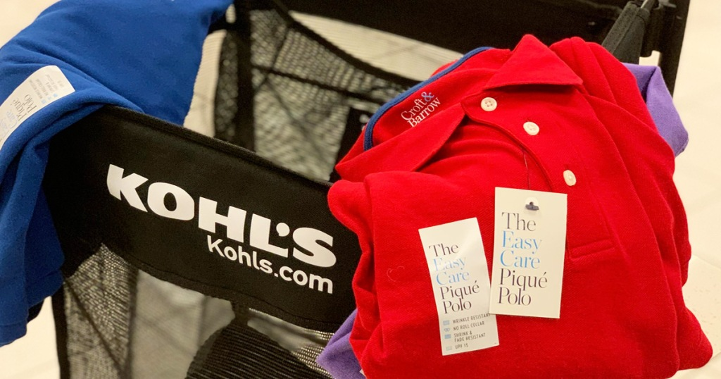 black kohls basket with mens polo shirts hanging on sides